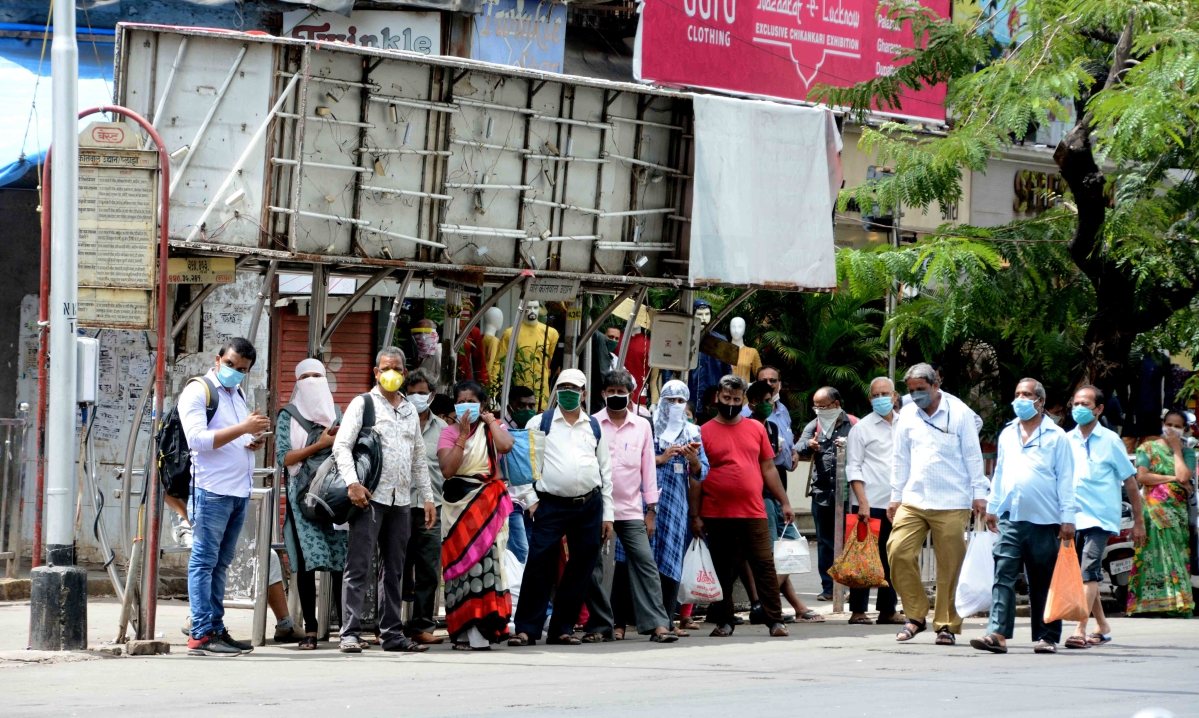 People waiting at a bus stop at Dadar on Thursday