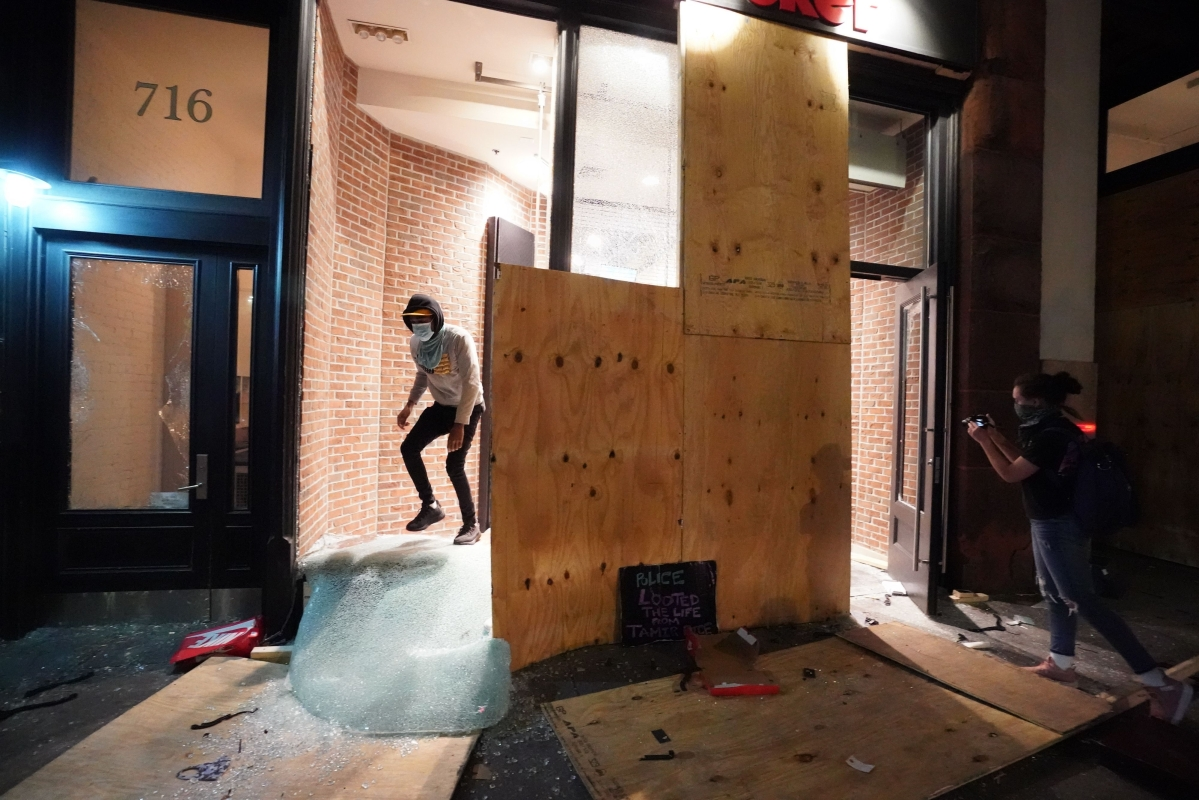 People loot a store during demonstrations over the death of George Floyd by a Minneapolis police officer on June 1, 2020 in New York.