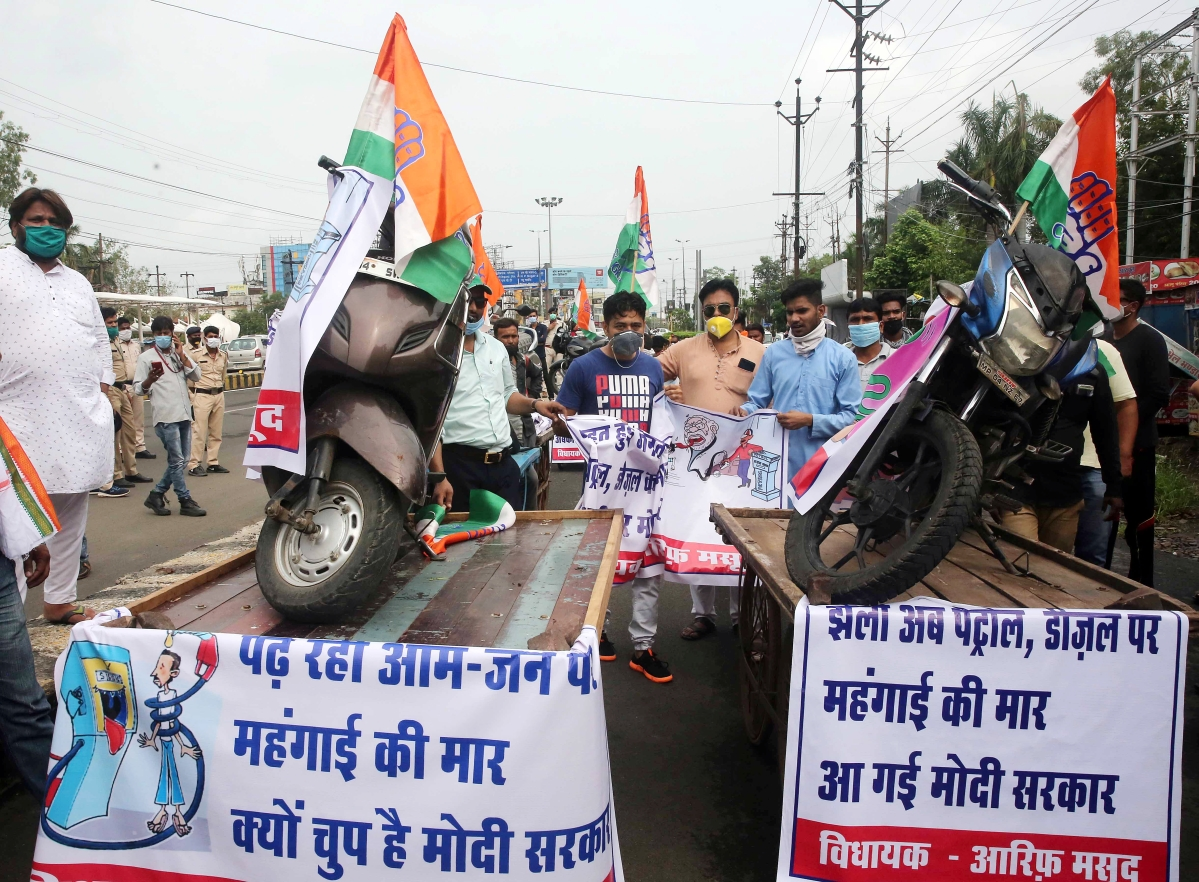 Congress supporters take out a rally protesting against Union Government over hiked fuel price, in Bhopal on Tuesday.