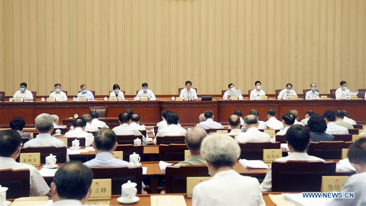 Li Zhanshu, chairman of the National People's Congress (NPC) Standing Committee, presides over the first plenary meeting of the 20th session of the 13th NPC Standing Committee at the Great Hall of the People in Beijing, capital of China, June 28, 2020.