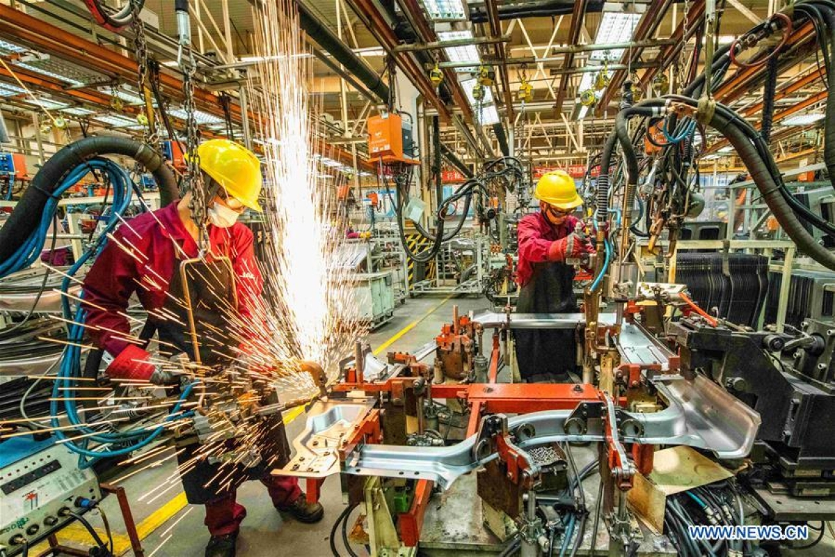 Workers weld at a workshop of an automobile manufacturing enterprise in Qingzhou City, east China's Shandong Province, June 30, 2020.