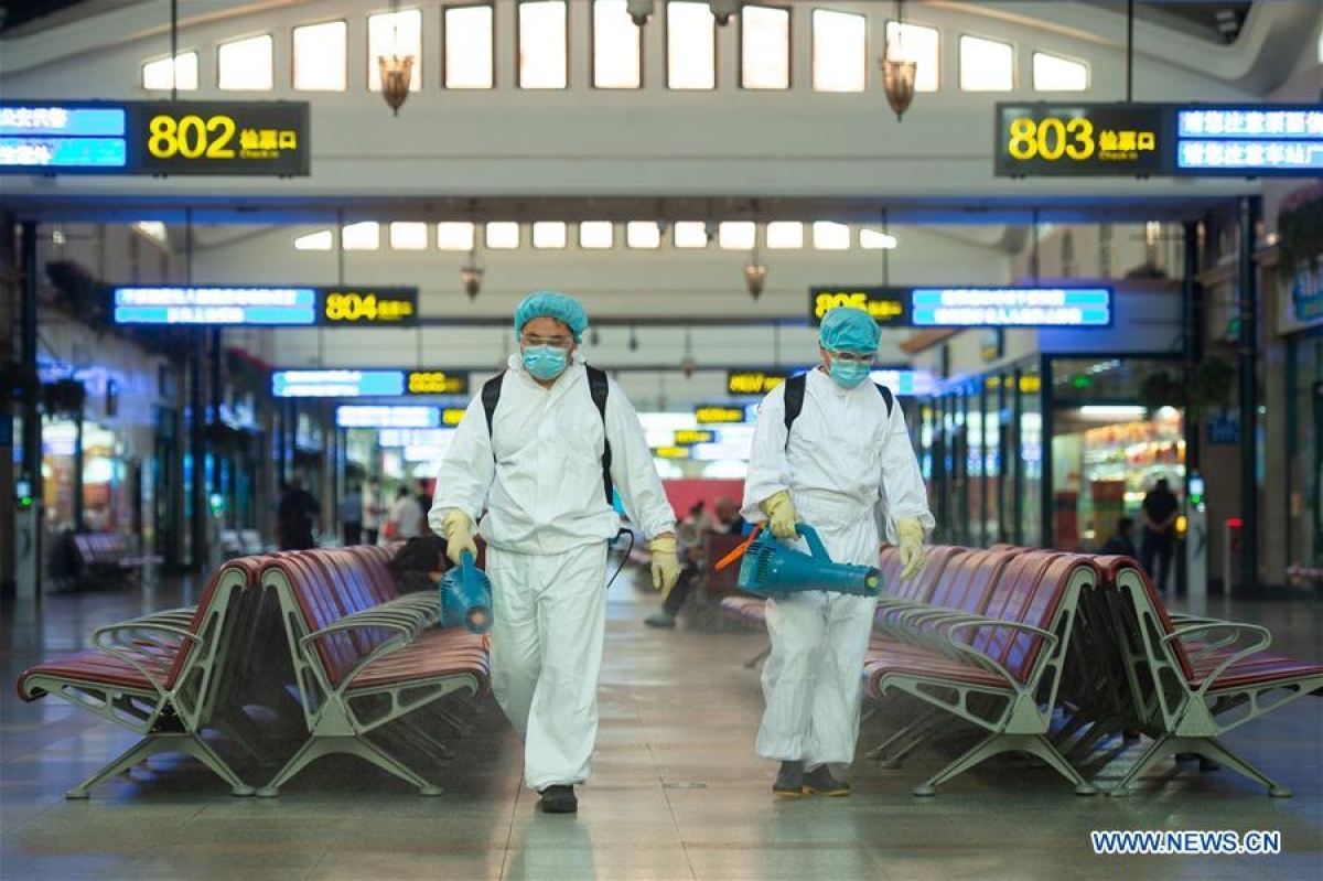 Staff members disinfect a waiting room of Beijing Railway Station in Beijing, capital of China, June 18, 2020. Following the upgrade of emergency response to COVID-19 from Level III to Level II in Beijing, Beijing Railway Station has conducted strict measures to prevent and control the spread of the epidemic.