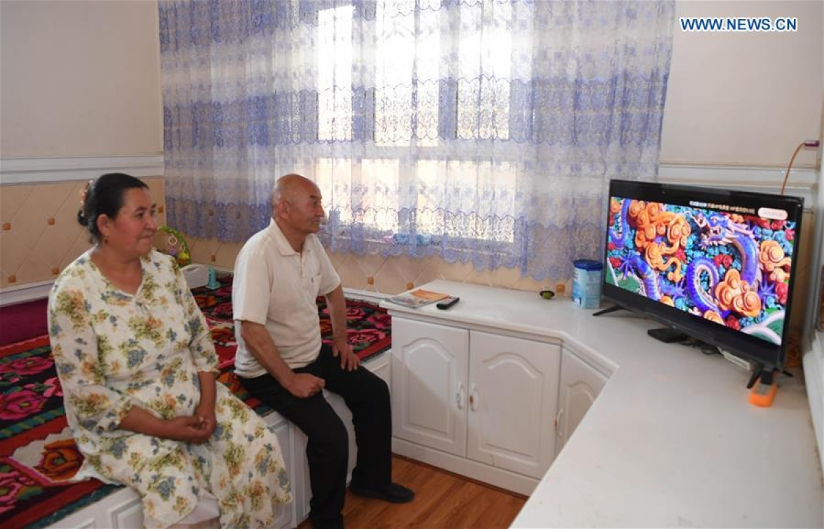 Villagers watch TV at their house in Kokyar Township of Yutian County in Hotan Prefecture, northwest China's Xinjiang Uygur Autonomous Region, May 21, 2020.