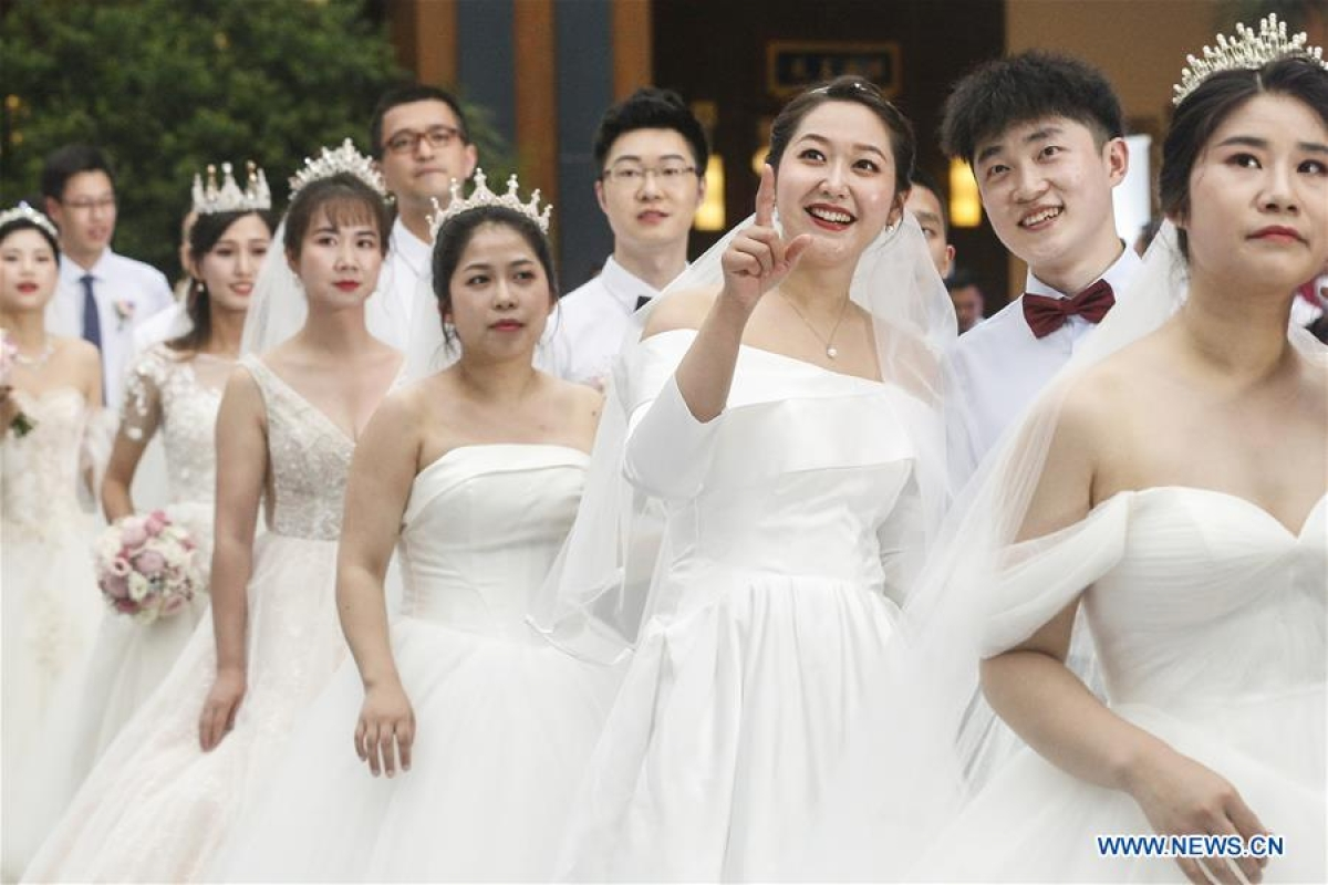 Newly-married couples get ready to attend a group wedding ceremony in Boao, south China's Hainan Province, June 6, 2020. A group wedding ceremony was held here on Saturday for 30 newly-married couples from Beijing, Wuhan, Guangzhou among others. Some of the newly married people's wedding ceremonies had been postponed by their work in the fight against coronavirus outbreak in Hubei Province.