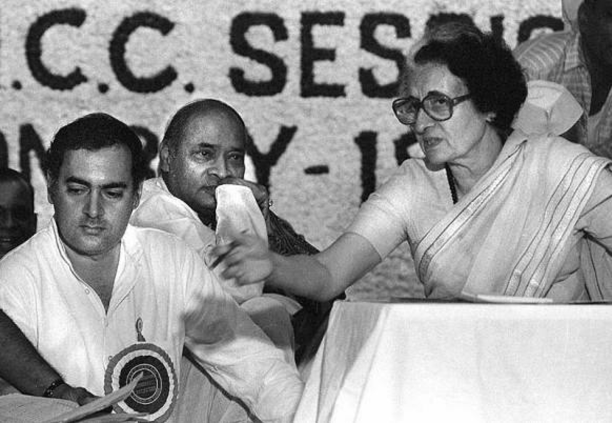 Indira and Rajiv Gandhi, with Rao in the background.