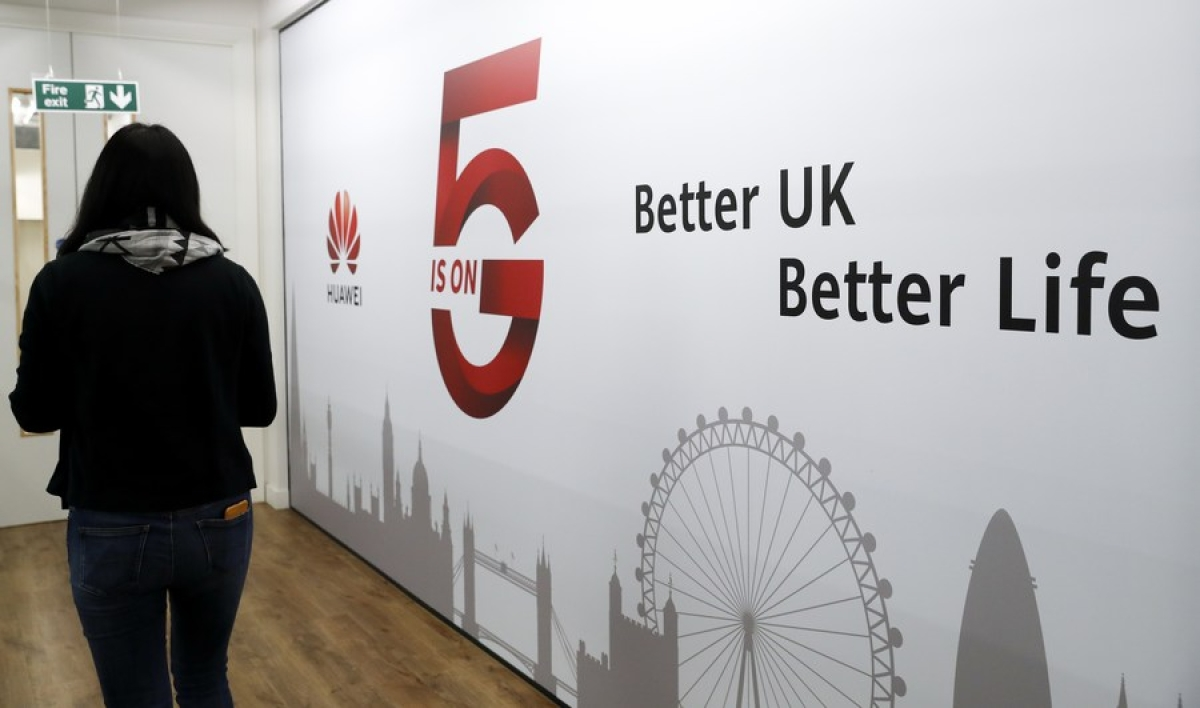A staff member walks past Huawei 5G Innovation and Experience Center in London, Britain, on Jan. 28, 2020.