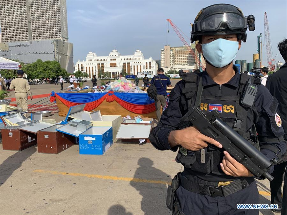 A military police officer stands guard during a drug burning ceremony in Phnom Penh, Cambodia, on June 26, 2020. Cambodia on Friday burned down 477.7 kg of illicit drugs to mark the International Day Against Drug Abuse and Illicit Trafficking, officials said.