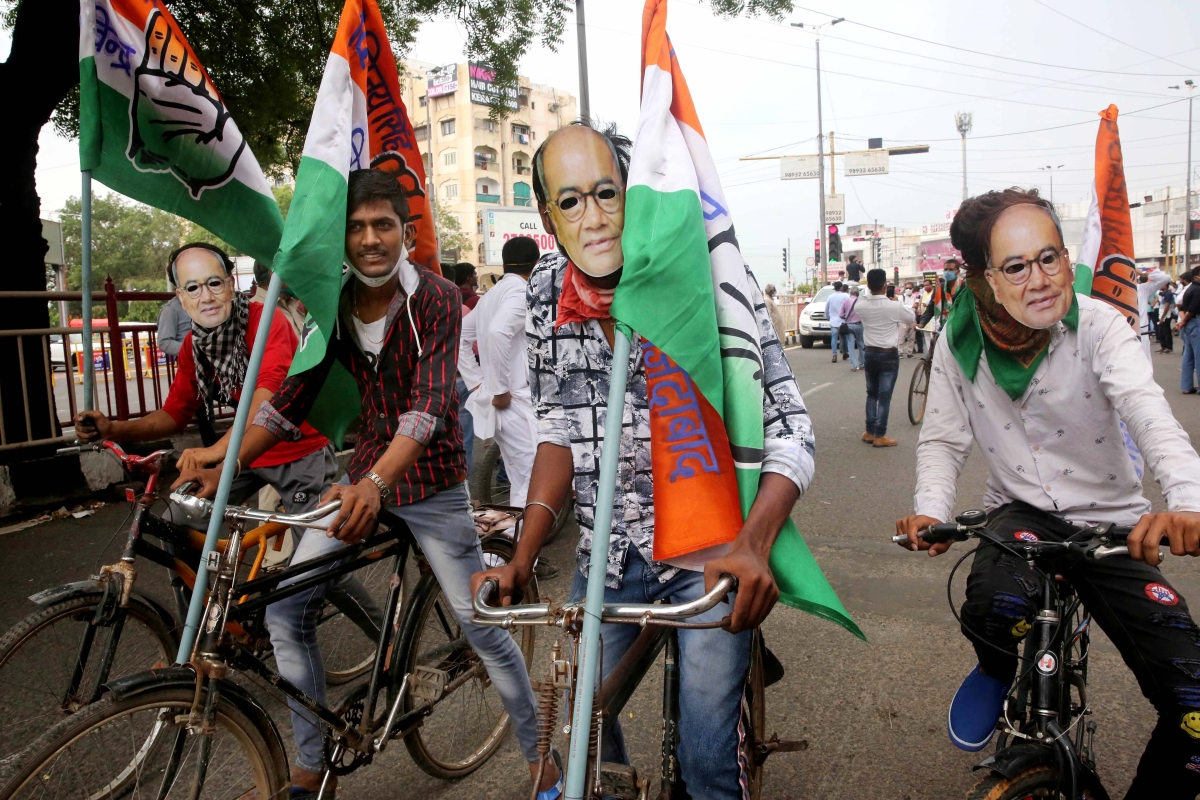 Congress supporters wear face cover of Digvijay Singh as the take part in a protest rally against the continuous price hike of petrol and diesel in Bhopal on Wednesday.