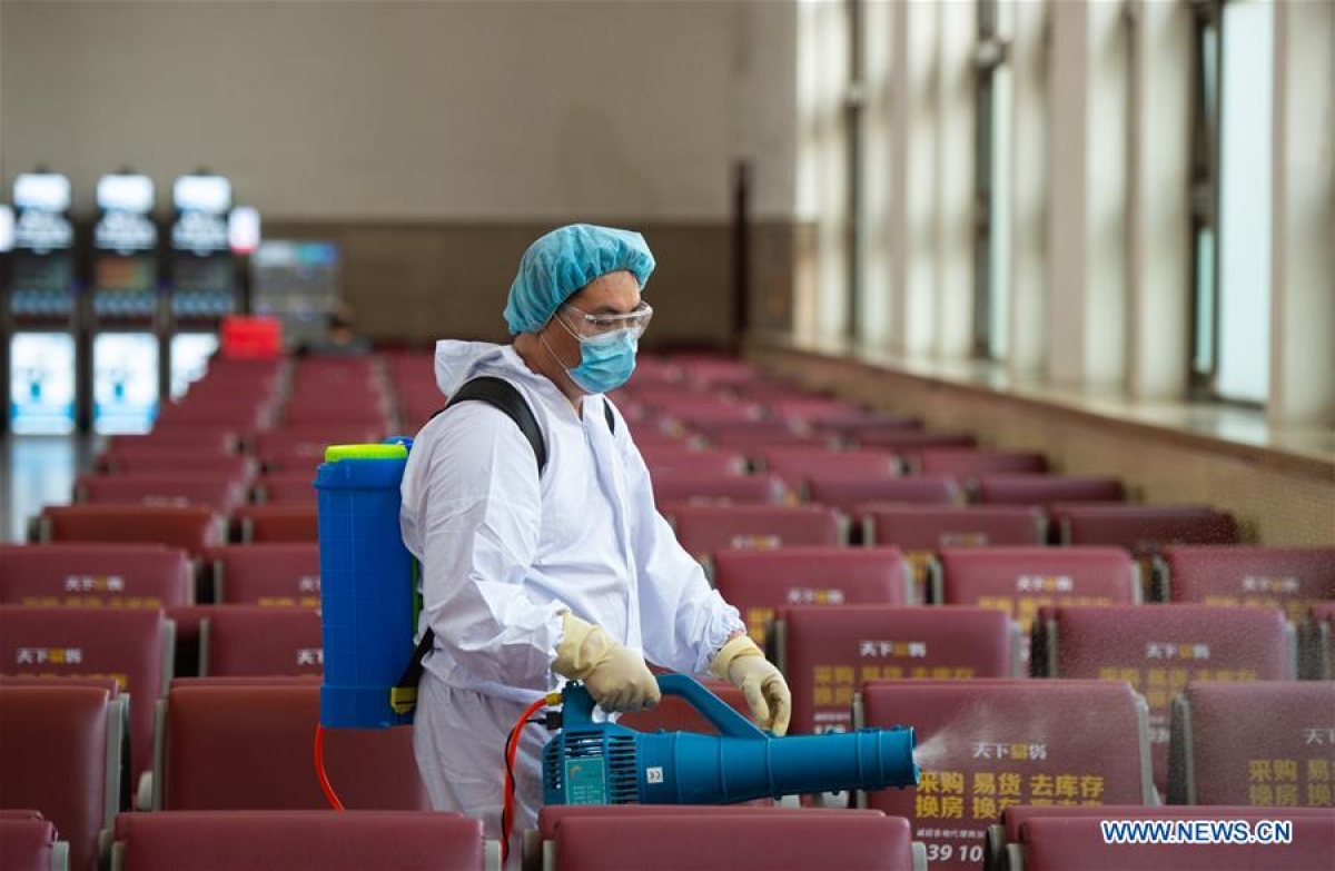 A staff member disinfects a waiting room of Beijing Railway Station in Beijing, capital of China, June 18, 2020. Following the upgrade of emergency response to COVID-19 from Level III to Level II in Beijing, Beijing Railway Station has conducted strict measures to prevent and control the spread of the epidemic.