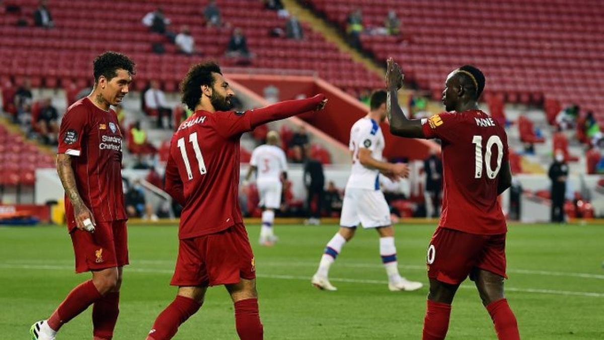 Roberto Firmino (L), Mohamed Salah and Sadio Mane