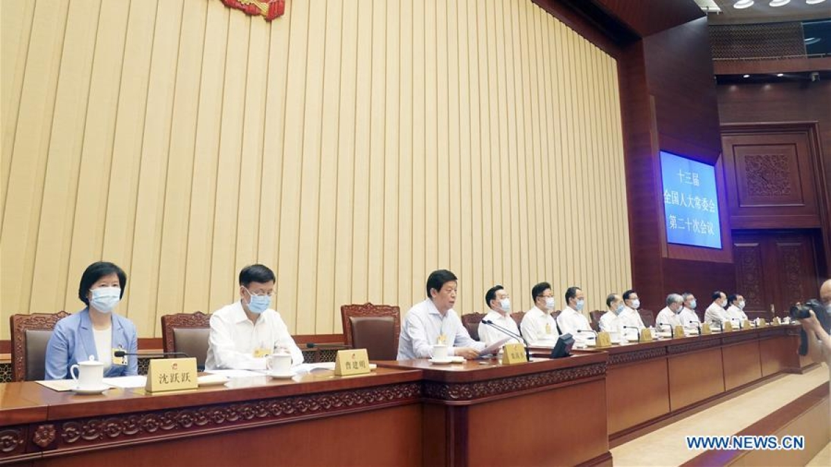 Li Zhanshu, chairman of the National People's Congress (NPC) Standing Committee, presides over the plenary meeting of the 20th session of the 13th NPC Standing Committee in Beijing, capital of China, June 30, 2020. The Standing Committee of the 13th National People's Congress (NPC), China's top legislature, closed its 20th session Tuesday, adopting the Law of the People's Republic of China on Safeguarding National Security in the Hong Kong Special Administrative Region (HKSAR).