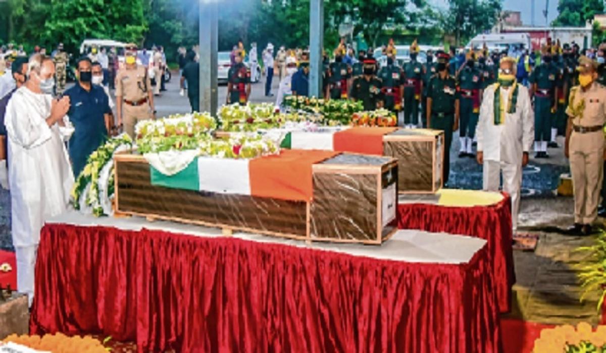 Odisha CM Naveen Patnaik pays a tribute to Sepoy Chandrakant  Pradhan and Naib Subedar  Nanduram Soren at Bhubaneswar Airport.