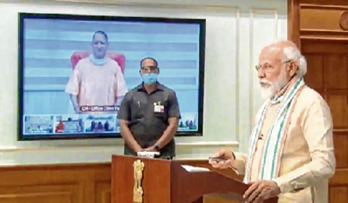 PM Modi launches the Atma Nirbhar UP Rozgar Abhiyan, in New Delhi on Friday.