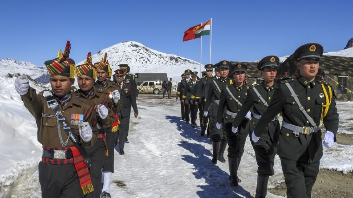 Top Indian and Chinese military commanders discuss 'outstanding issues' and agree to 'cool down' border situation