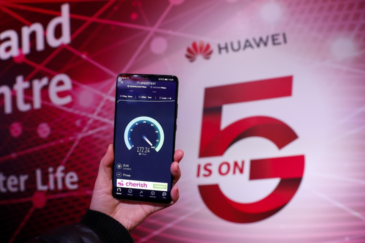 A staff member tests the speed with a Huawei 5G mobile phone at Huawei 5G Innovation and Experience Center in London, Britain, on Jan. 28, 2020.