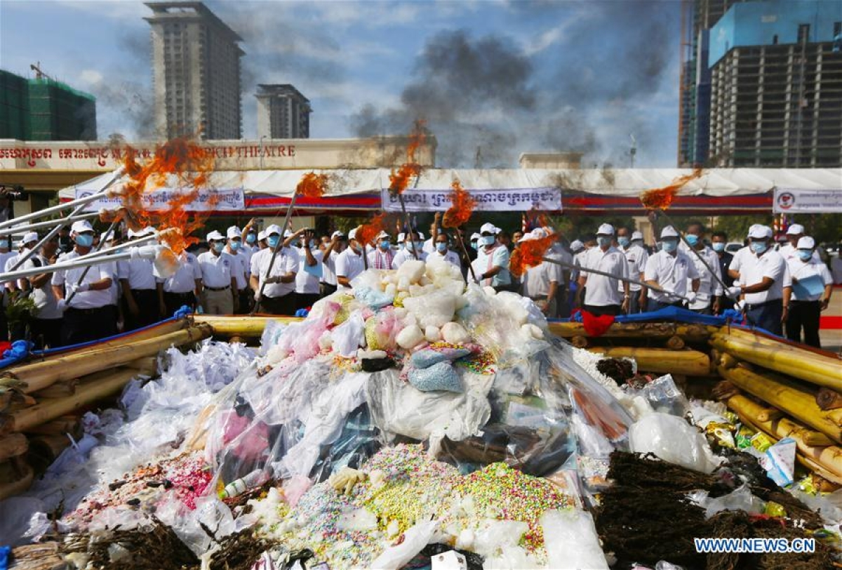 Officials set fire on illicit drugs during a ceremony in Phnom Penh, Cambodia, on June 26, 2020. Cambodia on Friday burned down 477.7 kg of illicit drugs to mark the International Day Against Drug Abuse and Illicit Trafficking, officials said.