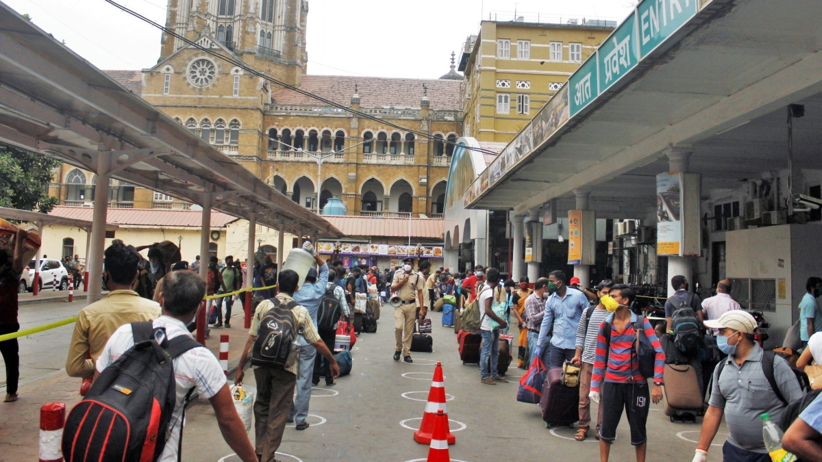 Passengers line up outside Chhatrapati Shivaji Maharaj Terminus (CSMT) to board a train that will take them to their native place.