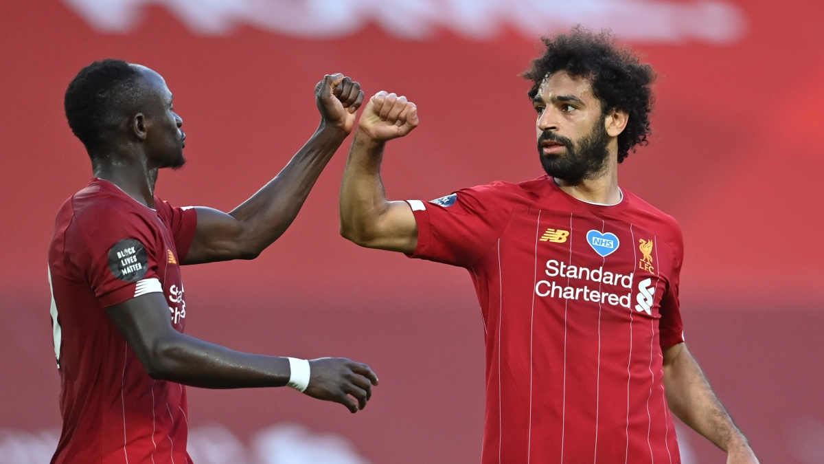 Liverpool's Sadio Mane (L), with Mohamed Salah
