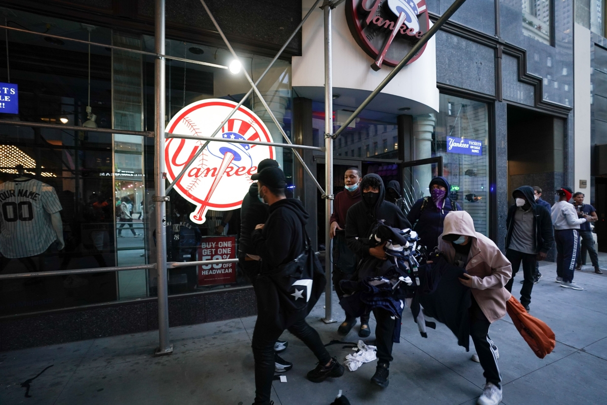 People loot a store during demonstrations over the death of George Floyd by a Minneapolis police officer on June 1, 2020 in New York