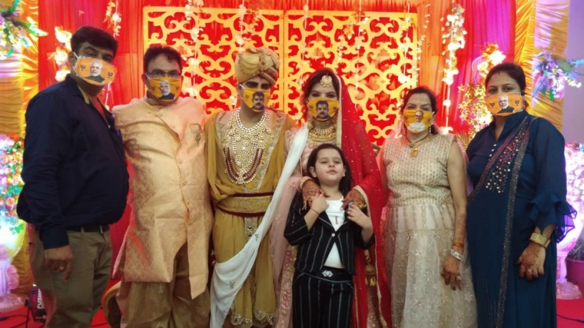 Saffron mask with BJP leaders' face at marriage party
