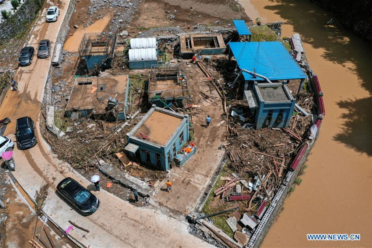 Aerial photo taken on June 13, 2020 shows houses devastated by flood in Bifeng Town of Zheng'an County in Zunyi, southwest China's Guizhou Province. Rain-triggered floods have affected more than 700,000 people in southwest China's Guizhou Province, with 29,500 individuals temporarily evacuated, authorities said Saturday.