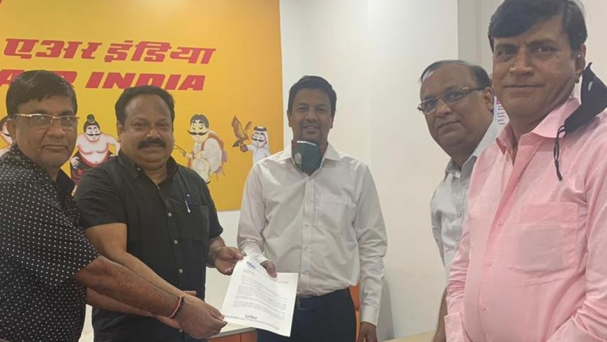 The members of the TAFI hand over a memorandum to AGM of Air India Vikas Shah at his office on Tuesday.