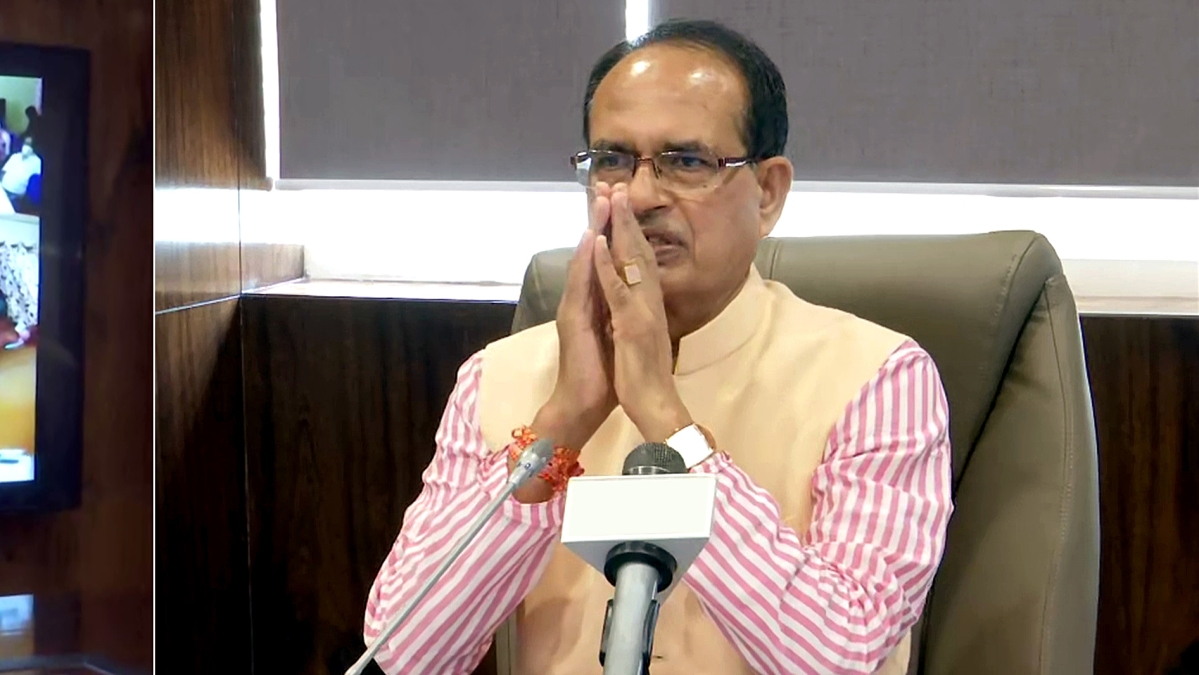 Madhya Pradesh Chief Minister Shivraj Singh Chouhan meets with electricity consumers through video conferencing over relief given to people over the electricity bill, in Bhopal on Monday.