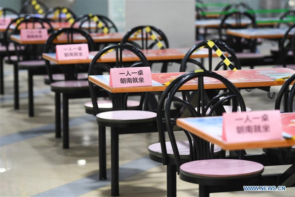 Photo taken on June 6, 2020 shows signs reminding students of social distancing at a canteen in Tsinghua University in Beijing, capital of China.
