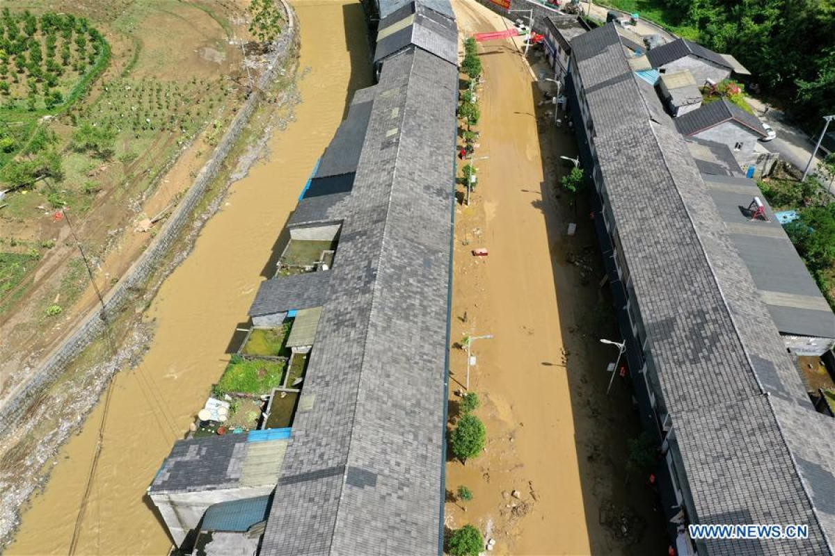 Aerial photo taken on June 13, 2020 shows silt covering the street at Bifeng Town of Zheng'an County in Zunyi, southwest China's Guizhou Province. Rain-triggered floods have affected more than 700,000 people in southwest China's Guizhou Province, with 29,500 individuals temporarily evacuated, authorities said Saturday.