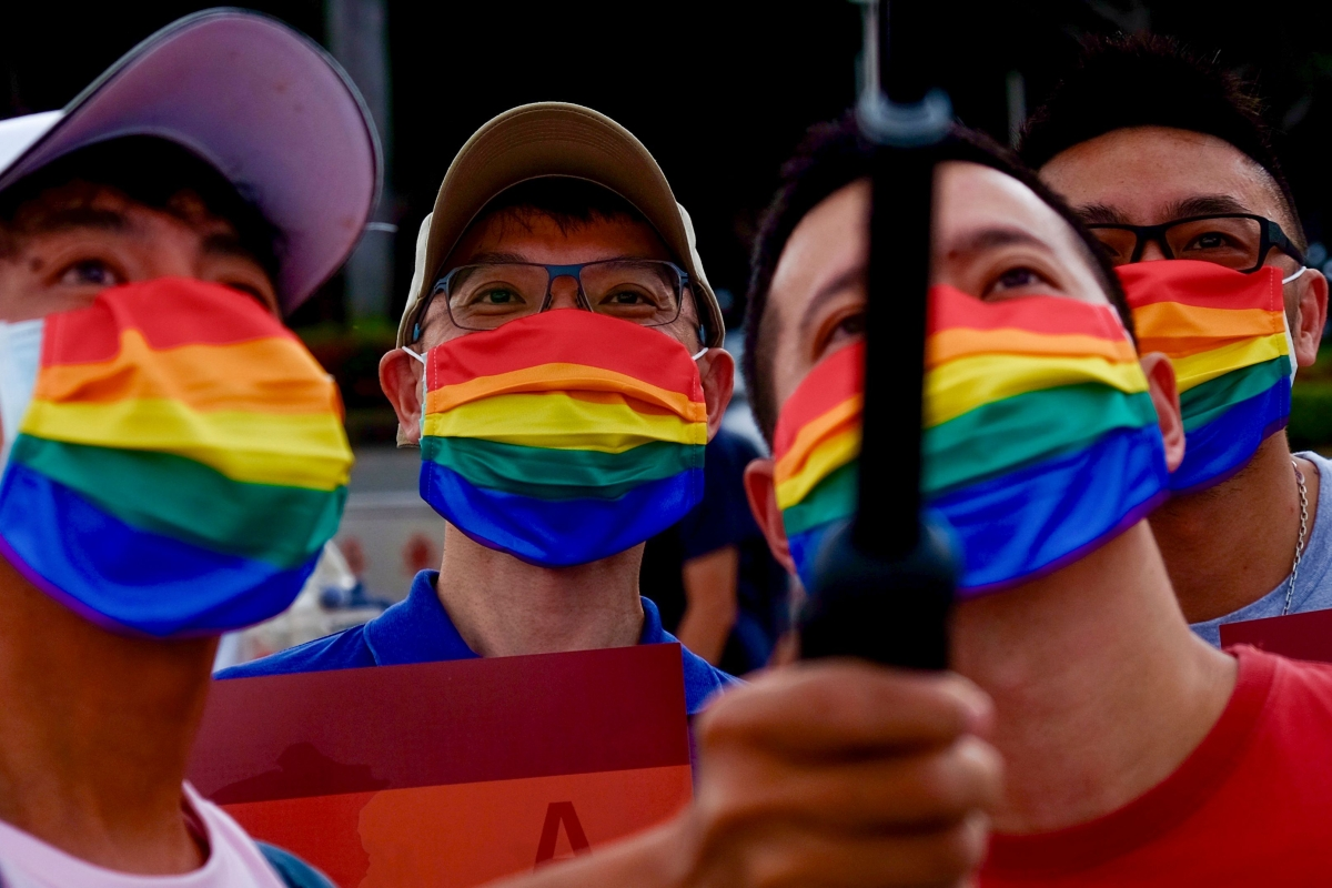 LGBT rights activists take selfies during a gay pride parade outside the Chiang Kai-shek Memorial Hall in Taipei.