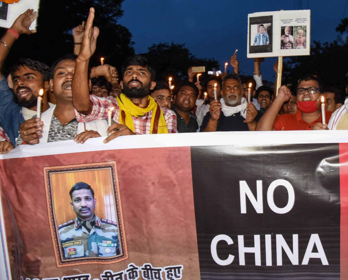 Jan Adhikar Party president Pappu Yadav along with supporters participates in a candle light march in solidarity with Colonel Santosh Babu, who was among 20 martyred during a clash with Chinese troops in Ladakh, in Patna on Thursday