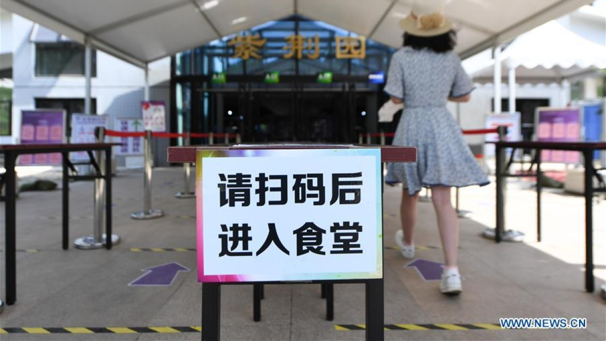 Photo taken on June 6, 2020 shows a sign reminding students to register their health information before entering a canteen in Tsinghua University in Beijing, capital of China.