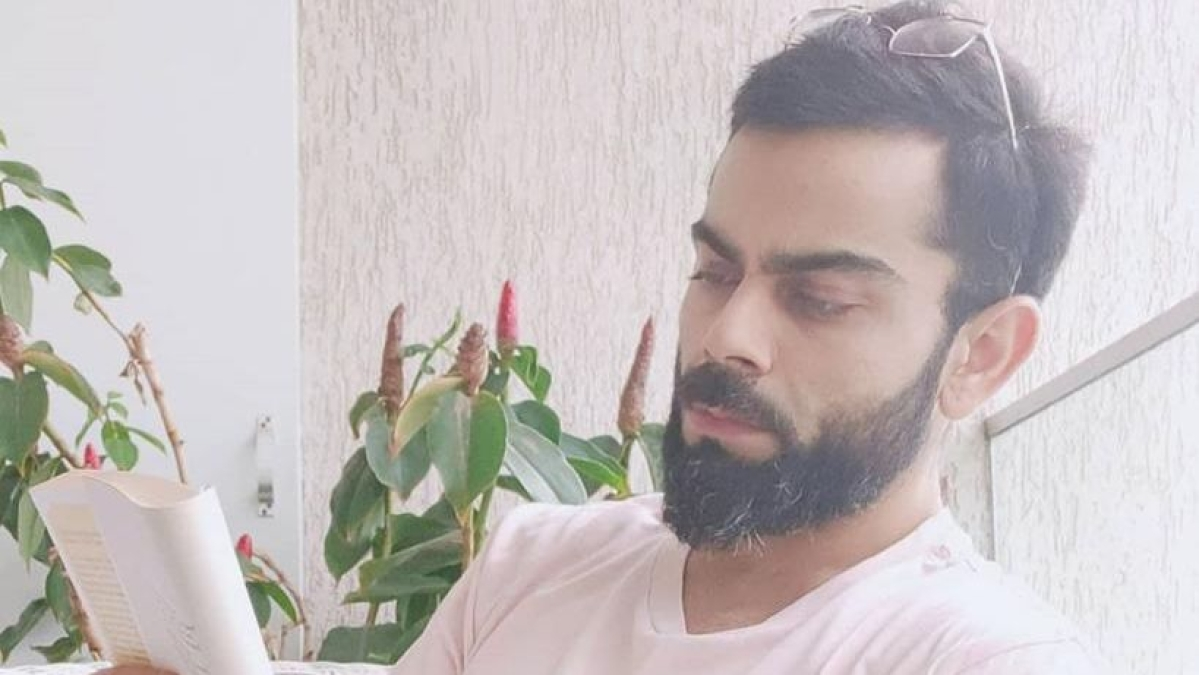 Indian cricket captain Virat Kohli enjoys his 'first proper experience' of Mumbai rains with a book in hand