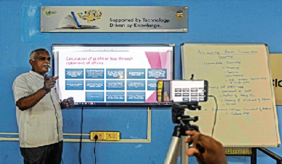 A school teacher gives a live streaming online class at a govt school in Chennai.