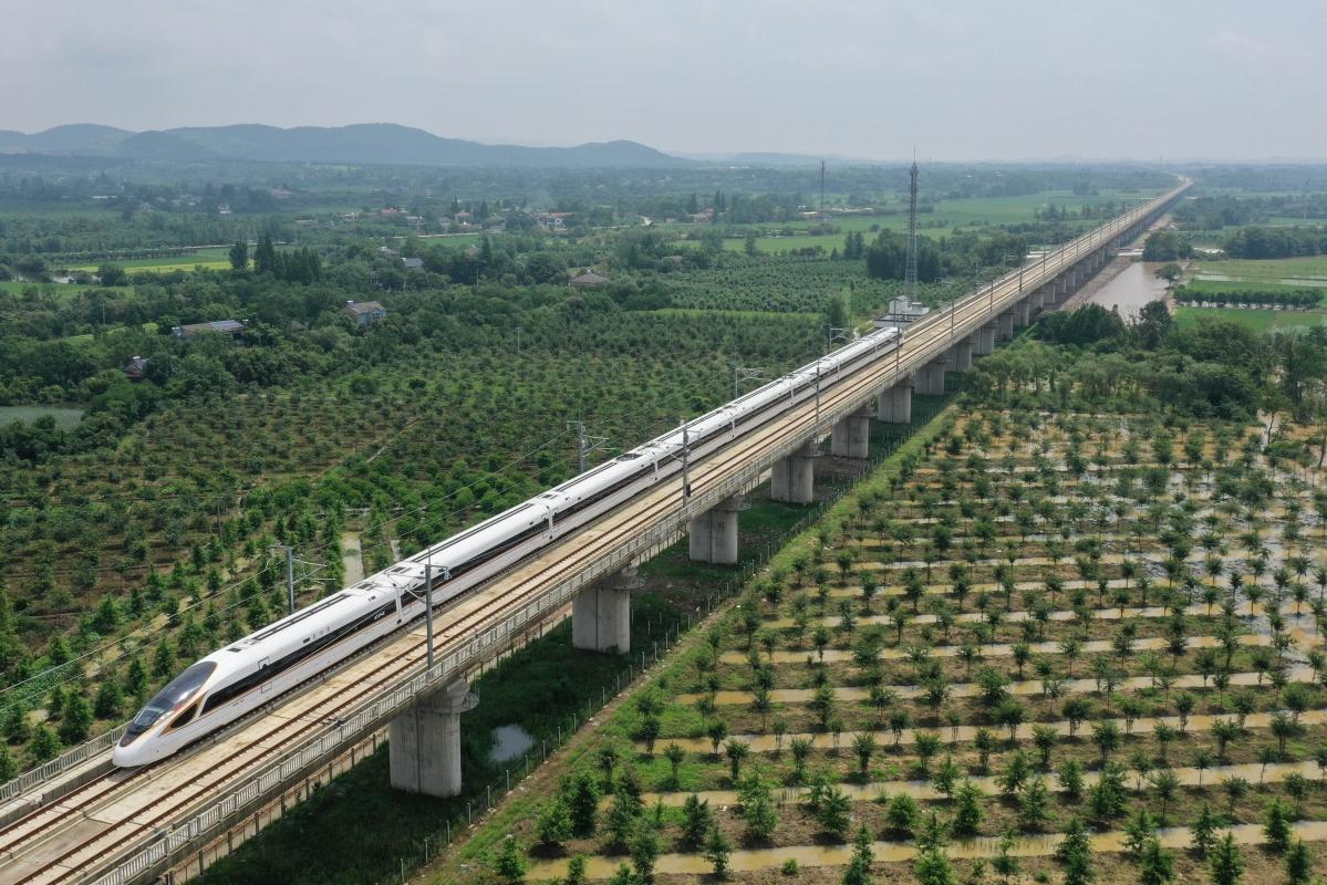 Aerial photo taken on June 28, 2020 shows a bullet train running on the Shangqiu-Hefei-Hangzhou high-speed railway in Anji County, east China's Zhejiang Province.