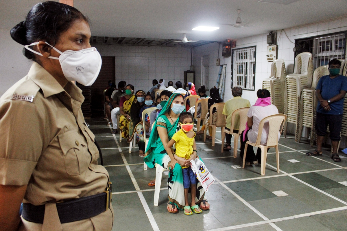 People wait in a queue to get tested for COVID-19, in Mumbai on Friday.