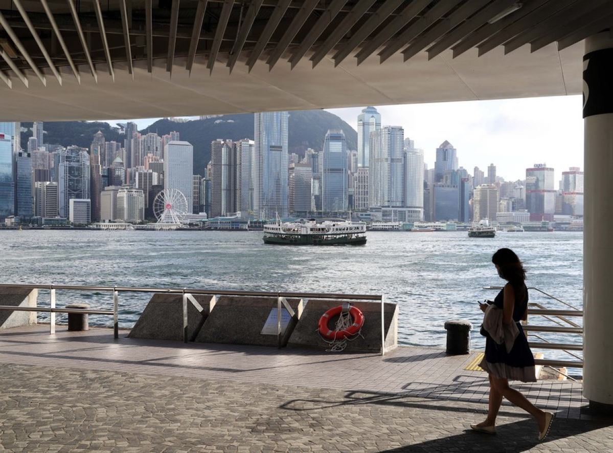 A woman walks by a wharf in Tsim Sha Tsui, Hong Kong, south China, July 16, 2020