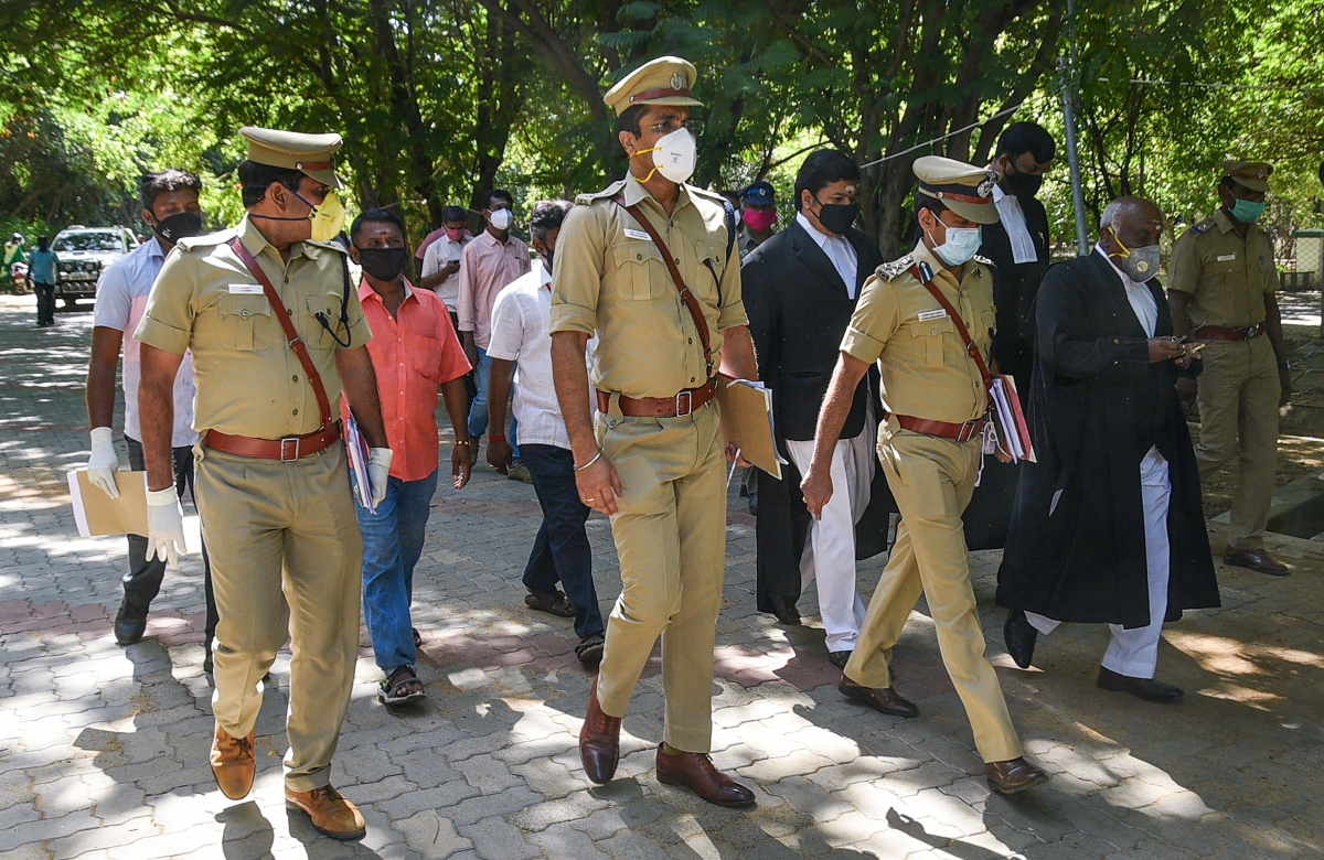 Thoothukudi SP Arun Balagopalan (C) Additional Superintendent of Police D Kumar (L), DSP C Prathapan (2nd from R) and police constable Maharajan ( extreme L) arrive to appear before the Madurai Bench of Madras High Court for Sathankulam custodial deaths, Tuesday, June 30, 2020.