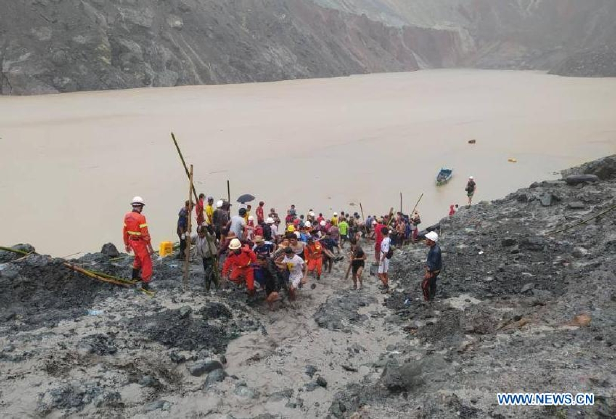 Photo taken by a smart phone on July 2, 2020 shows rescuers carrying the body of a victim after the landslides at a jade mining site in Hpakant, Kachin State, Myanmar.