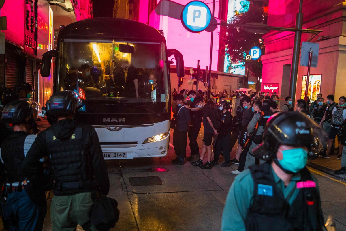 Police detain people on a bus after they cleared protesters taking part in a rally against a new national security law in Hong Kong on July 1, 2020, on the 23rd anniversary of the city's handover from Britain to China.