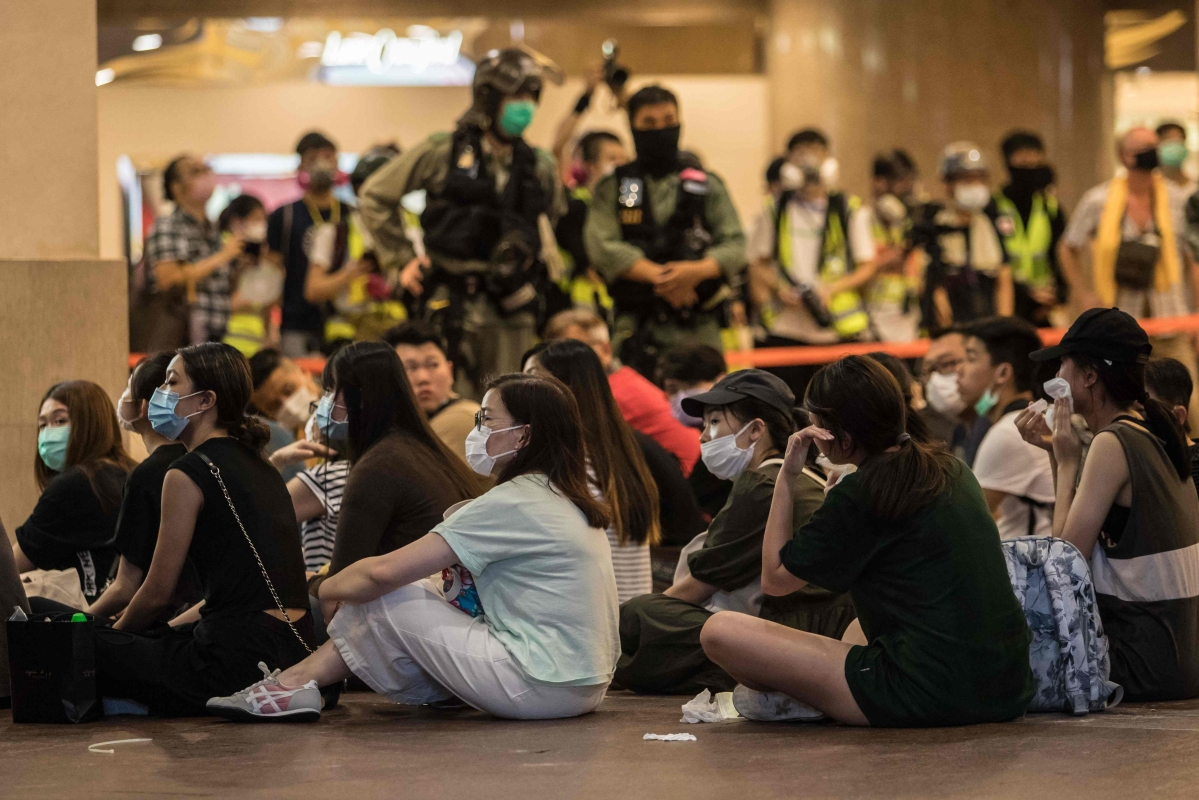 HK Police detain protesters rallying against new security law.