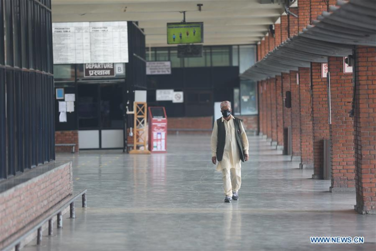 A man walks at the Tribhuvan International Airport in Kathmandu, Nepal, Aug. 22, 2020. The Nepali government has decided to resume scheduled international flights from Sept. 1 after nearly six months of flight suspension, a cabinet minister said on Friday. (Xinhua/Zhou Shengping)