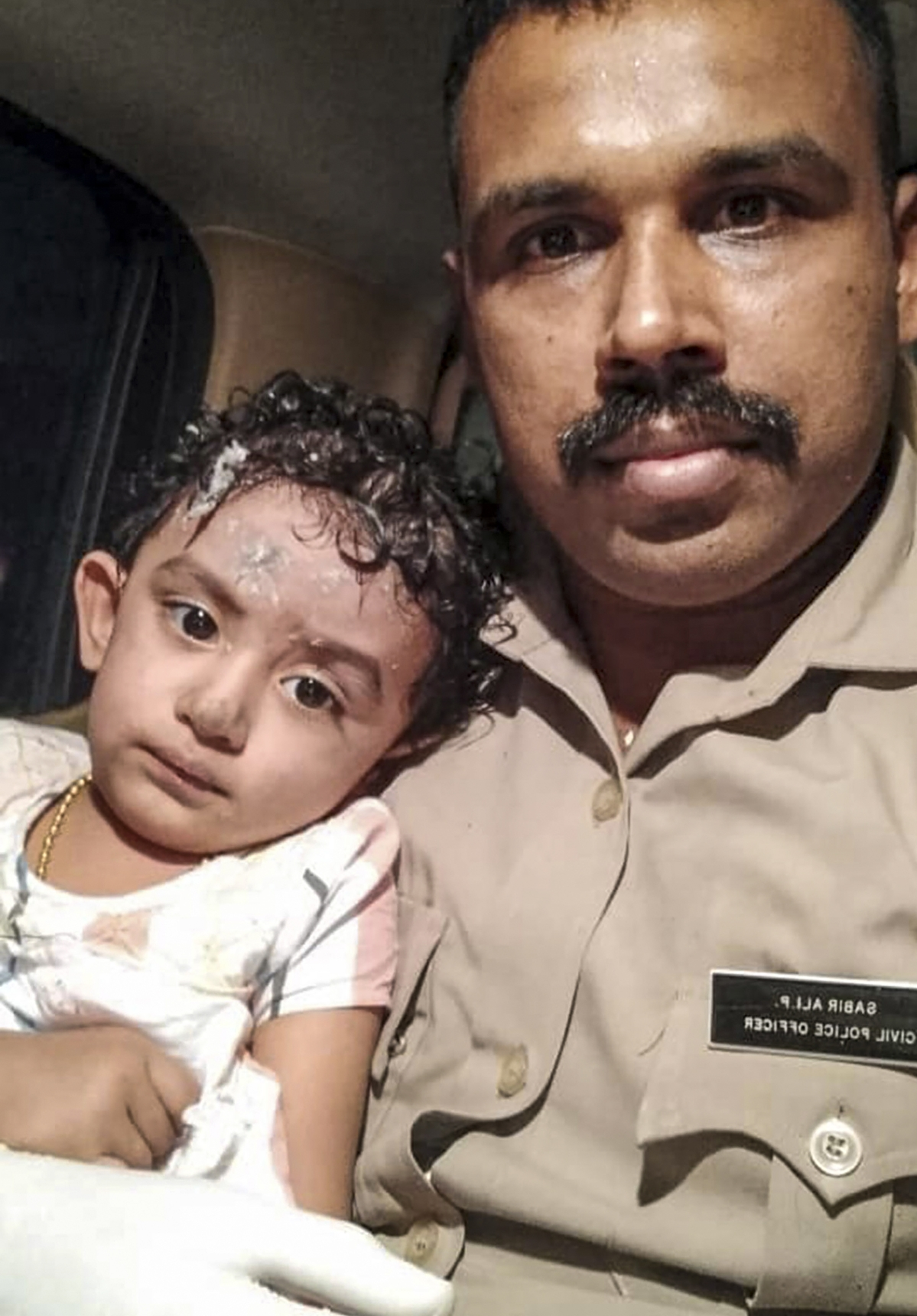 A child rescued after an Air India Express flight with passengers on board en route from Dubai skidded off the runway while landing, at Karippur in Kozhikode, Friday, Aug. 7, 2020.