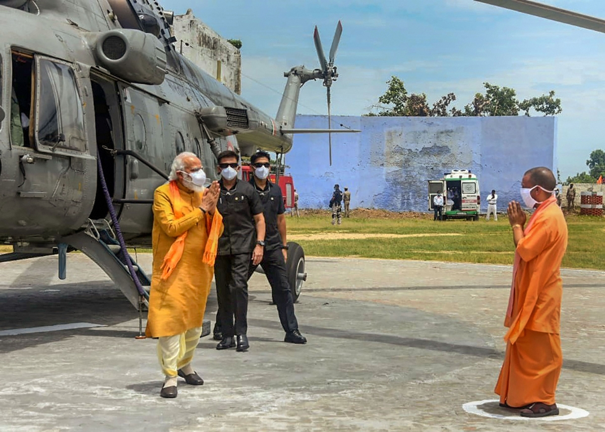 Prime Minister Narendra Modi being welcomed by Uttar Pradesh Chief Minister Yogi Adityanath ahead of the inception of Bhoomi Pujan for the construction of Ram Temple, in Ayodhya
