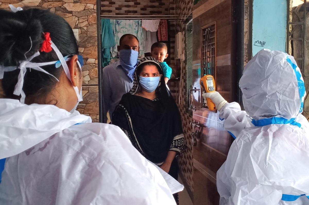 BMC health workers thermal checking at Mukund Nagar, Dharavi.