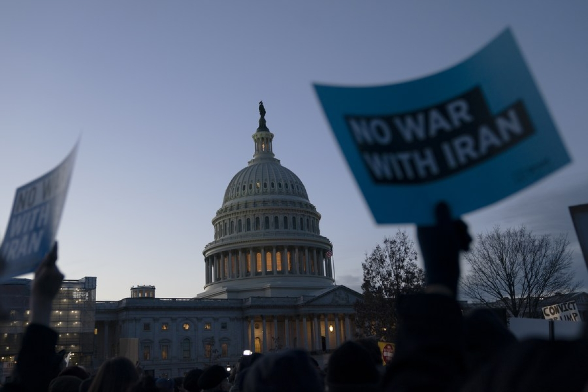 Signs are seen during a rally against war with Iran outside the Capitol Hill in Washington D.C., the United States, Jan. 9, 2020
