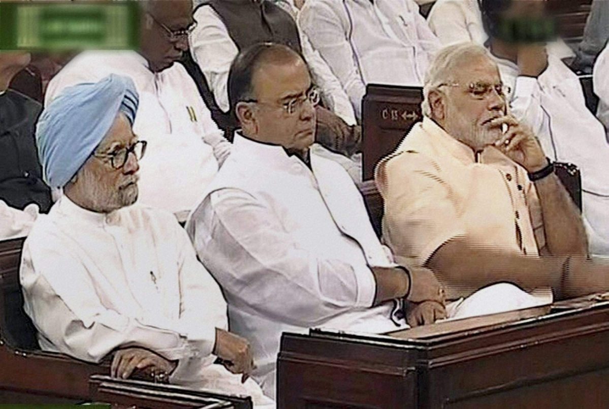 PM Narendra Modi with former PM Manmohan Singh and Finance Minister Arun Jaitley during President Pranab Mukherjee's address to the joint session of Parliament in New Delhi on 09/06/2014.