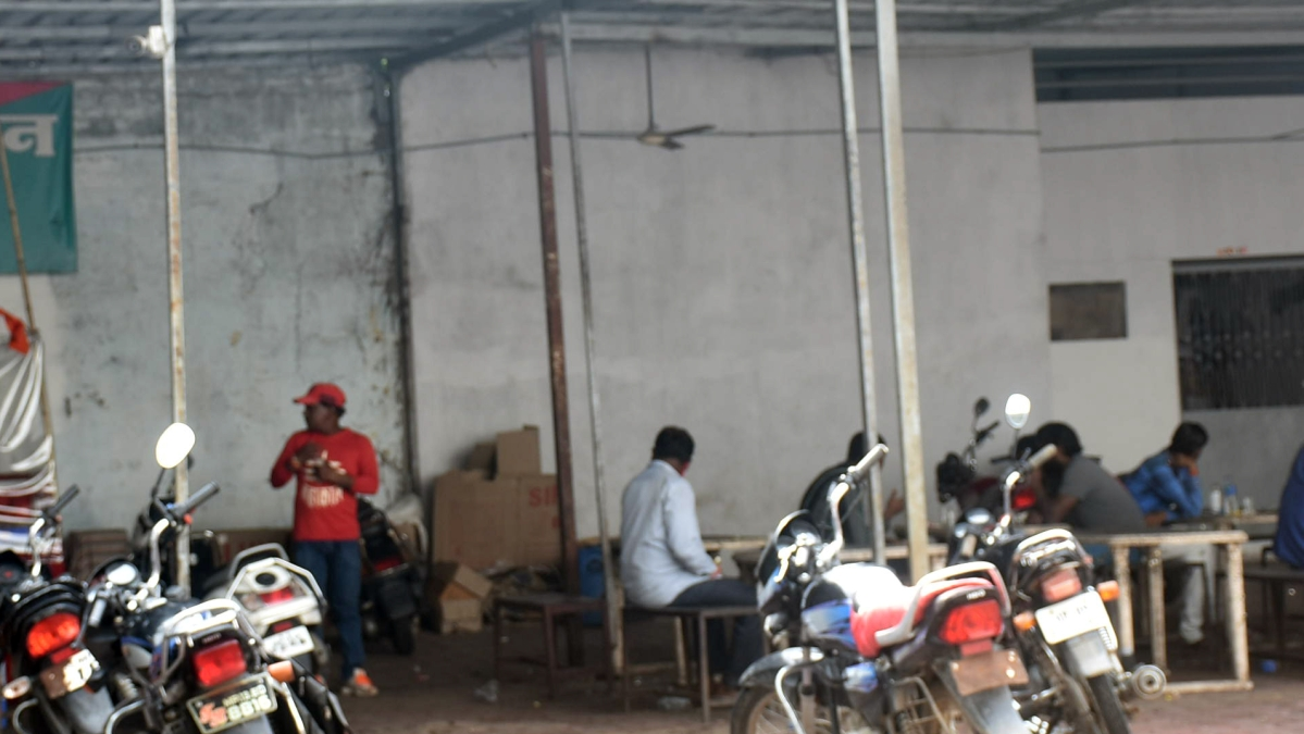 People enjoying country-made liquor at a covered go-down (ahaataa) located on Agar Road, in Ujjain on Saturday afternoon.