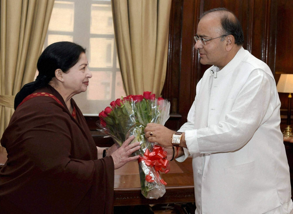 Tamil Nadu Chief Minister J Jayalalithaa presents a bouquet to Arun Jaitley at a meeting in New Delhi in June 2014.