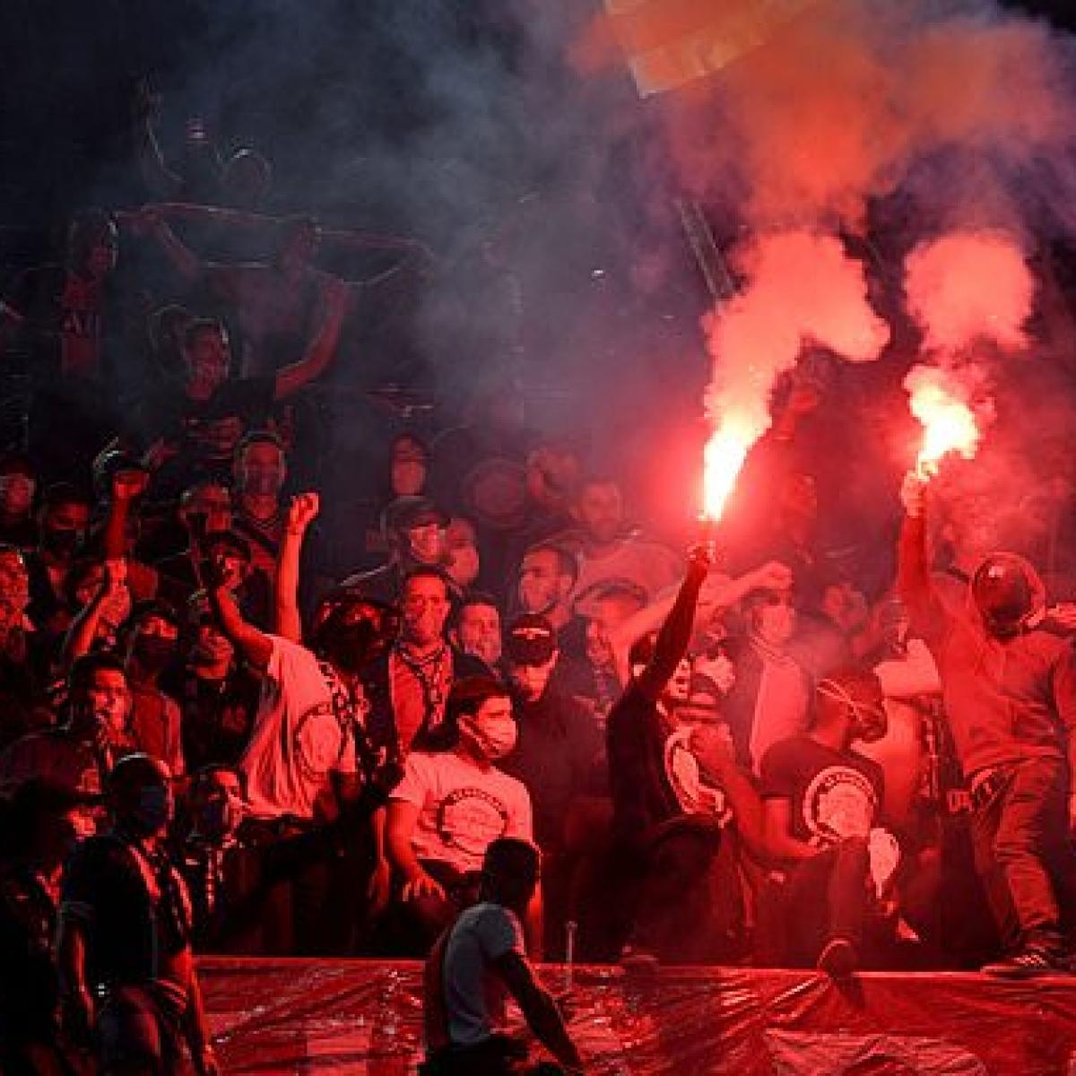 PSG fans clash with Paris riot police after Champions League defeat against Bayern Munich